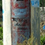 Sign mentioning arsenic contaminated water source in Raichur